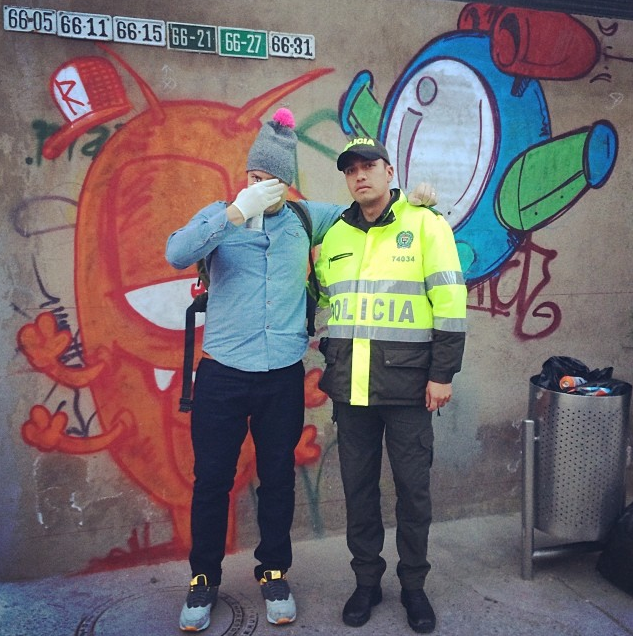 Ronzo & a police officer in Bogotà. Pic via his Instagram.